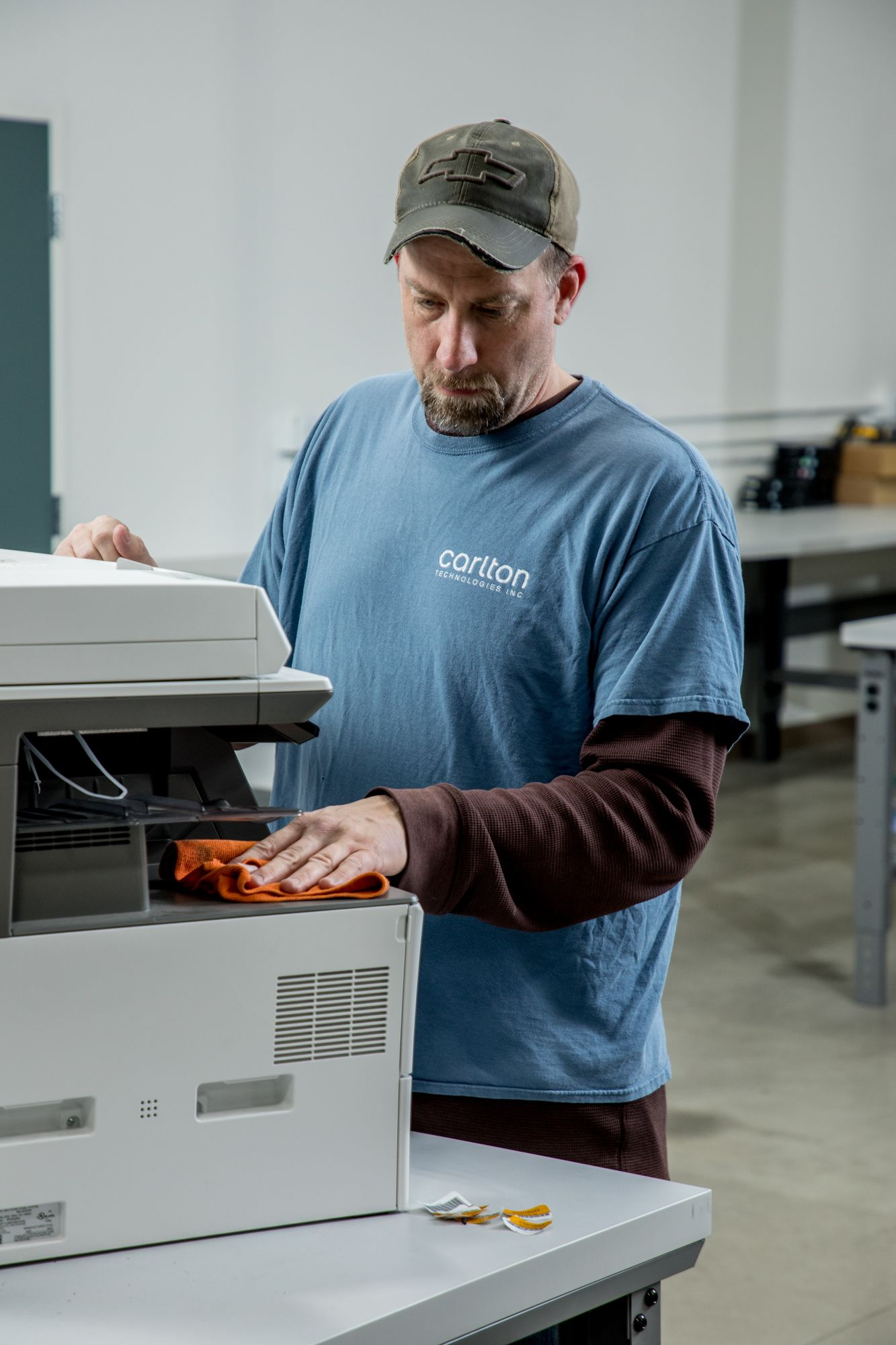 onsite printer technician cleaning office printer