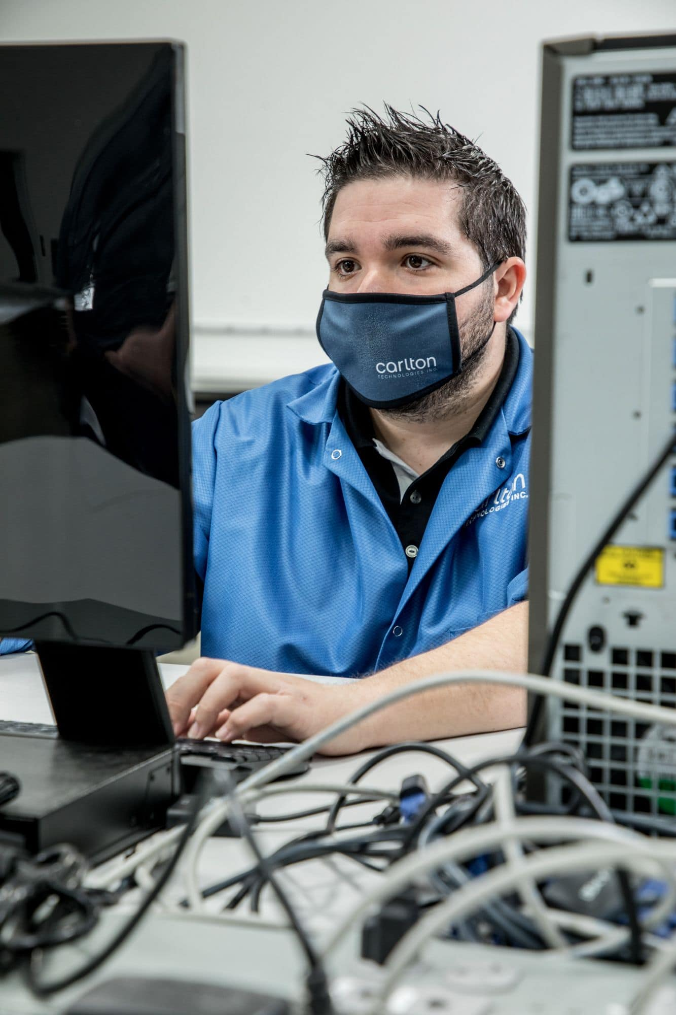 technology troubleshooting field service technician working on a pc